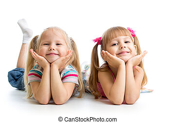 Two kids girls lying together