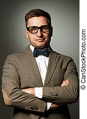 Confident nerd in eyeglasses and bow tie