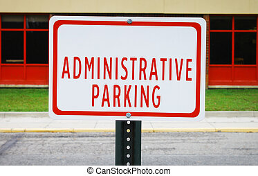 An Administrative parking sign in front of a windowed...