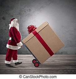 Santa Claus with big Christmas present in a cart