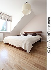 Huge bed - Huge wooden bed in bright spacious bedroom