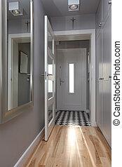 Stylish corridor - Bright corridor with open door in modern...