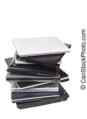 Laptops - Pile of old laptops isolated on white background
