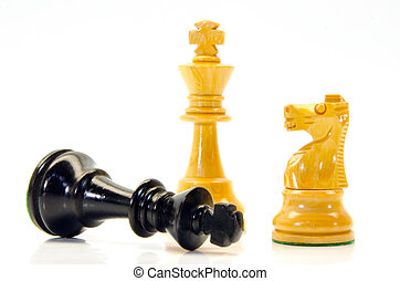 Chess - illustration of wooden chess figures with king lying