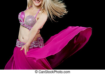 Exotic belly dancer isolated on black - Beautiful smiling...