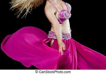 Cropped image of a young belly dancer - Belly dancer wearing...