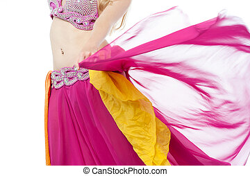 Belly dancer in action, cropped image. - Cropped image of a...