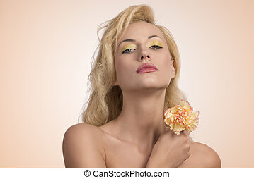 beauty blonde girl with flower