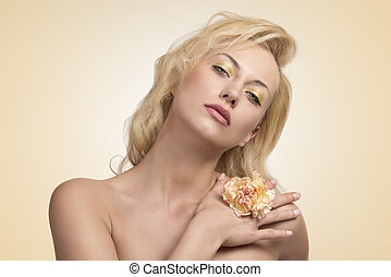 sensual blonde woman with flower