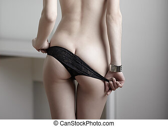 Undressing - Woman body indoors in lingerie Rear view