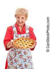 Grandmas Homemade Cherry Pie - Sweet grandmother holding a...