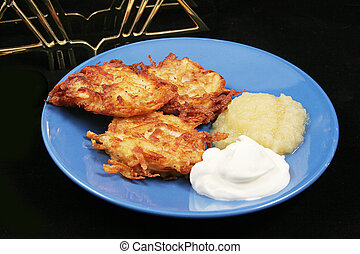 Potato Pancakes - Latkes For Hanukkah - A plate of delicious...