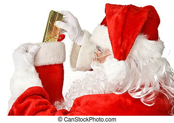 Santa Claus - Stocking Stuffer - Santa Clause putting a...
