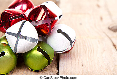 Christmas jingle bells on a plank - Christmas jingle bells...