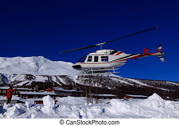 heli skiing air bound - Skiers air bound, headed for a...