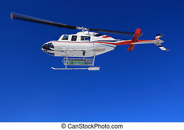 Heli skiing sky is the limit. - Skiers air bound, headed for...