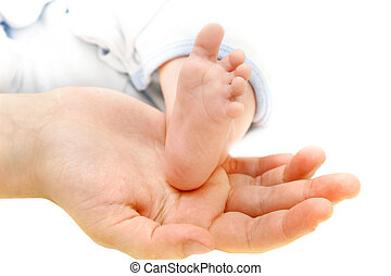 baby\'s foot on parents\' hand