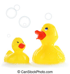 Yellow mother and child rubber ducks in bath foam