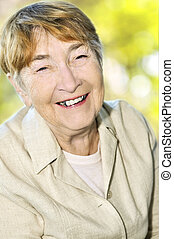 Elderly woman smiling - Senior woman laughing and smiling...