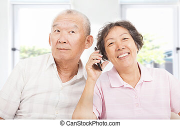 happy seniors couple talking on the phone