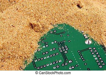 Silicon Valley 3 - Computer component half buried in sand