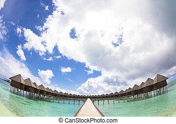beautiful water villa with cloud . maldives