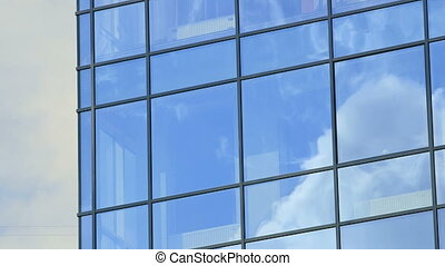 Modern glass building exterior - Time-lapse Detail of modern...
