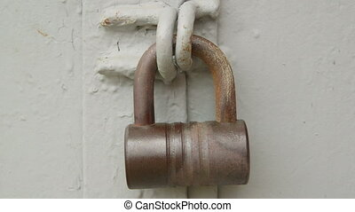 Hands unlocking padlock - Male hands with key unlocking...