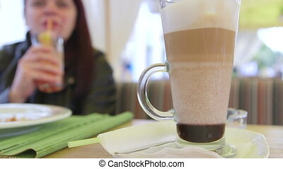 Mocha coffee at sidewalk cafe - Woman drinking mocha coffee...