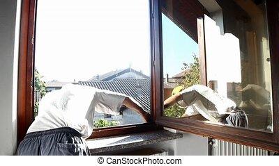 man working on a wooden window