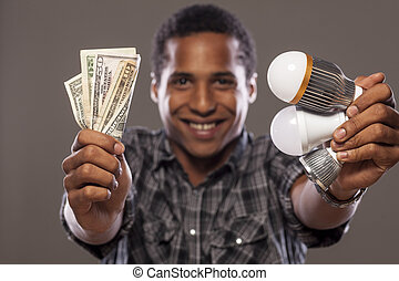 My savings - smiling dark-skinned young man showing money...