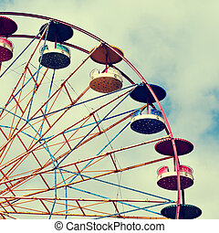 Ferris wheel - cutout of a Ferris wheel over the sky, with a...