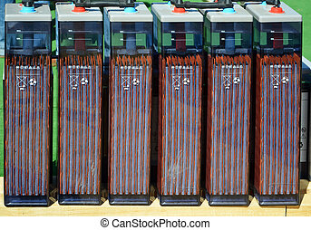 row of accumulators - row of interconnected electric...