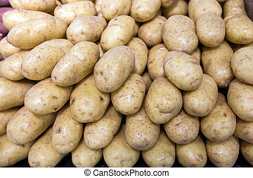 Potatos in food store - Potatos on a stall in food store