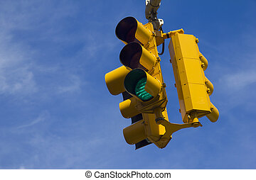 Traffic light on green - Suspended traffic light on green in...