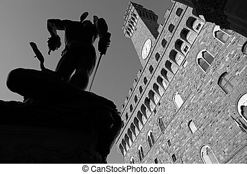 Palazzo Vecchio and silhouette of the statue of Perseus by...