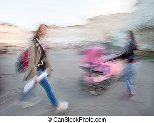 girl hurrying and women with a baby in a stroller - The...