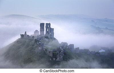 Foggy Corfe Castle - Corfe Castle rising through early...