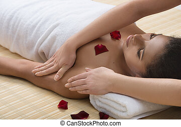 Beauty treatment at SPA. Beautiful young women getting...