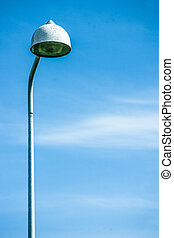 Tall streetlight lamp isolated on blue