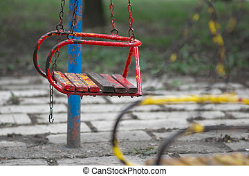 Swing - Old red swing on a playground