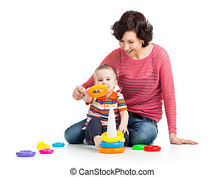 kid boy and mother play together