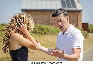 Man shouting and girl cover her ears in a quarrel