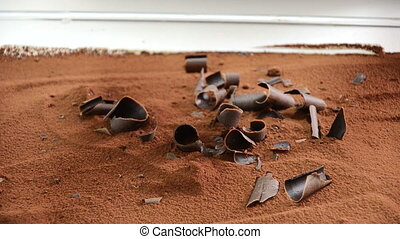 Chocolate fall into cream - Chocolate piece fell into the...