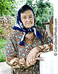 Old woman - Portrait of a romanian old woman in the...