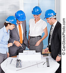 Architect Working Together - Group Of Architects At Meeting...