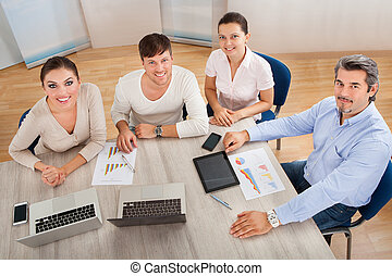 Happy Business People At Office - Businesspeople Discussing...