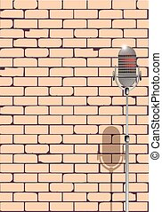 Karaoke - A microphone ready on stage against a brick wall...