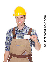 Architect Holding Visiting Card - Happy Male Architect...