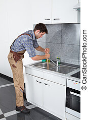 Young Man With Plunger - Young Handsome Man Using Plunger In...